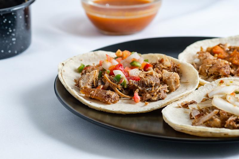 Mexican carnitas tacos, traditional food of Michoacán stock image