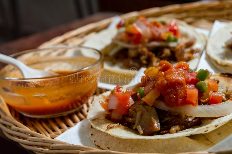 Mexican carnitas tacos, traditional food of Michoacán. Mexican carnitas tacos, slow cooked pulled pork, traditionally from the state of Michoacán and made royalty free stock photography