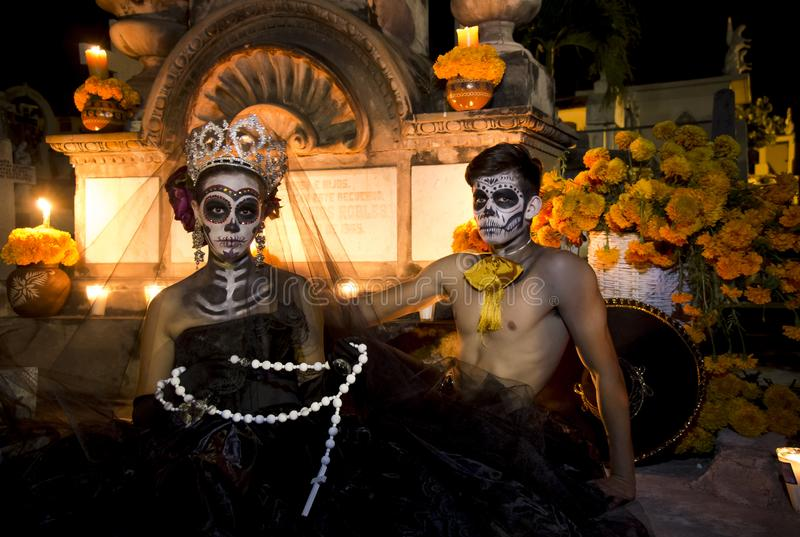 Mexican Catrina and Catrin in a cementery royalty free stock images