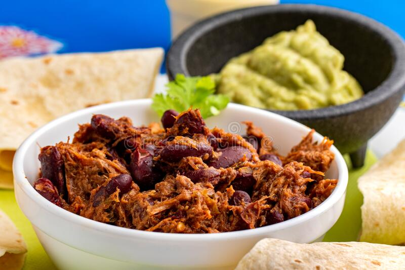 Homemade Mexican chili with beef dish. Close up traditional Mexican chili with meat dish. Grilled meat with garlic, onions, tomatoe and red beans stock images