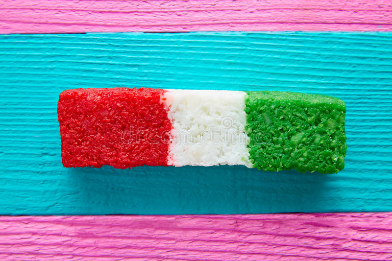 Mexican coconut flag candy striped chredded. Sweet from Mexico stock photos