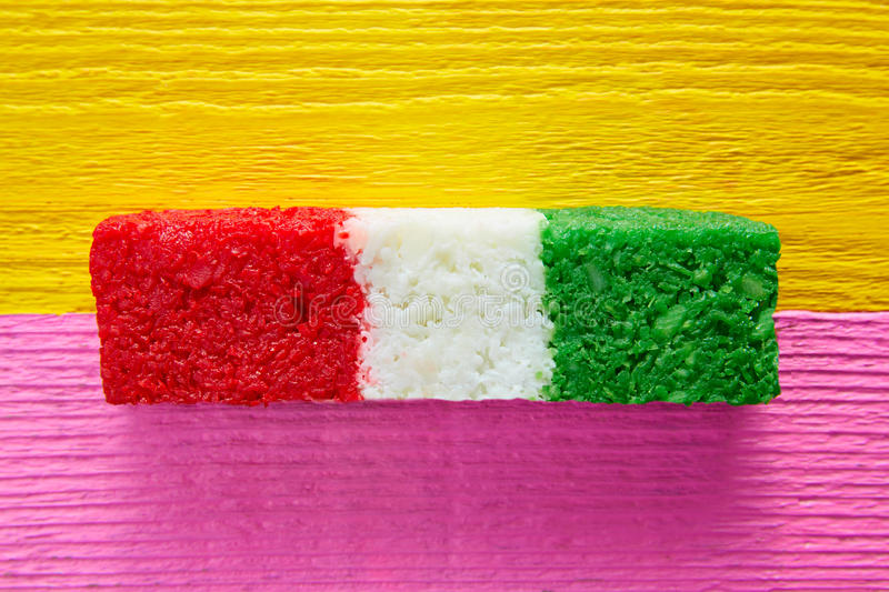 Mexican coconut flag candy striped chredded. Sweet from Mexico stock photography