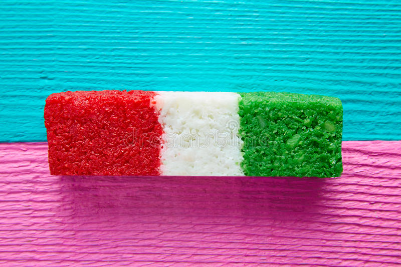 Mexican coconut flag candy striped chredded. Sweet from Mexico stock photo