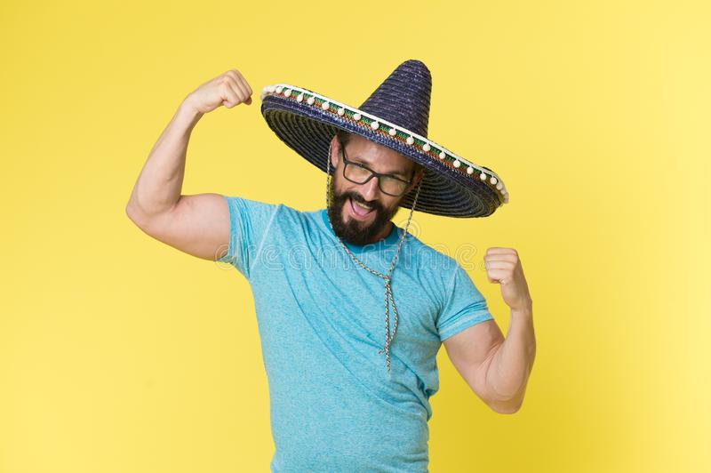 Mexican concept. Happy man smile in mexican hat. Mexican man in sombrero hat. Mexican party celebration royalty free stock photography