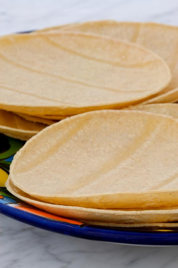 Delicious mexican corn tortillas. Mexican corn tortillas on retro vintage carrara marble in beautiful talavera plate, perfect for all your Mexican and tex-mex stock images