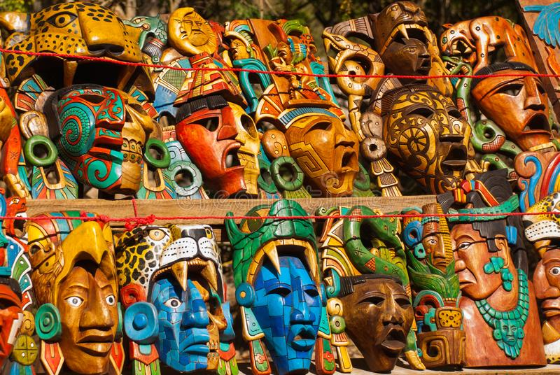 Mexican crafts for tourists on the market. Colorful Souvenirs, masks of Mayan warriors. Mexico royalty free stock images