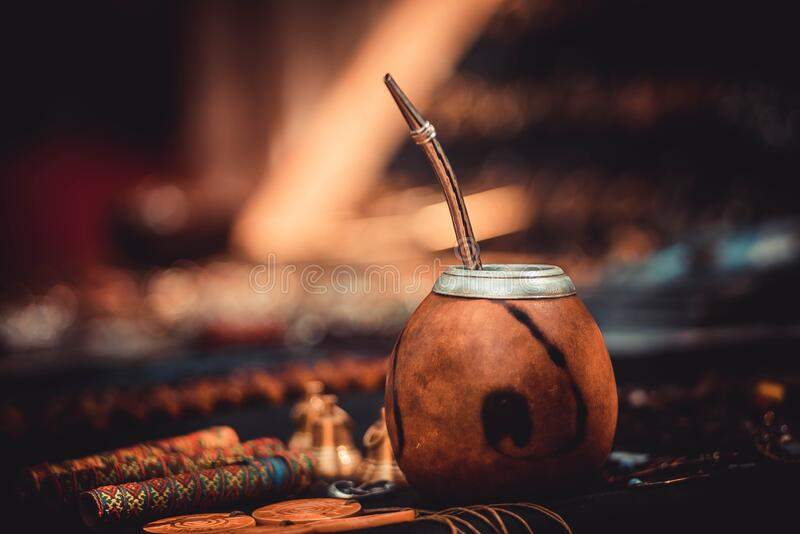 Mexican cup calabash for pumpkin mate tea is on the table royalty free stock image