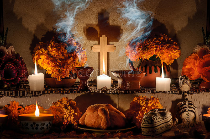 Mexican day of the dead altar (Dia de Muertos). Traditional mexican Day of the dead altar with pan de muerto and candles