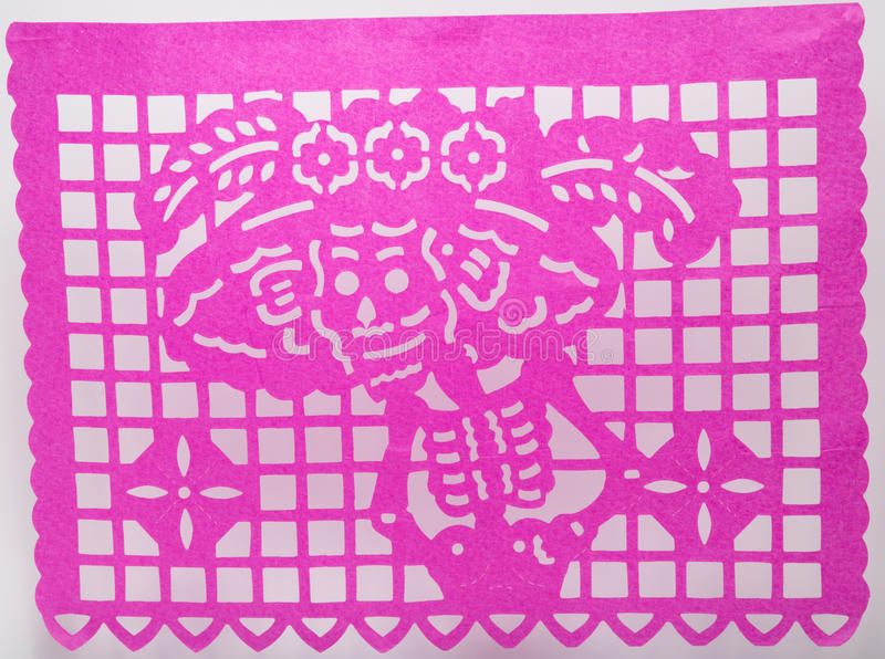 Mexican dia de muertos papel picado cut paper skull art featuring Catrina. Mexican dia de muertos papel picado cut paper skull art used in offerings ofrendas royalty free stock image