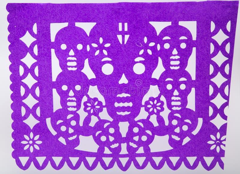 Mexican dia de muertos papel picado cut paper skull art. Used in offerings ofrendas featuring calaveras skulls catrina royalty free stock photo