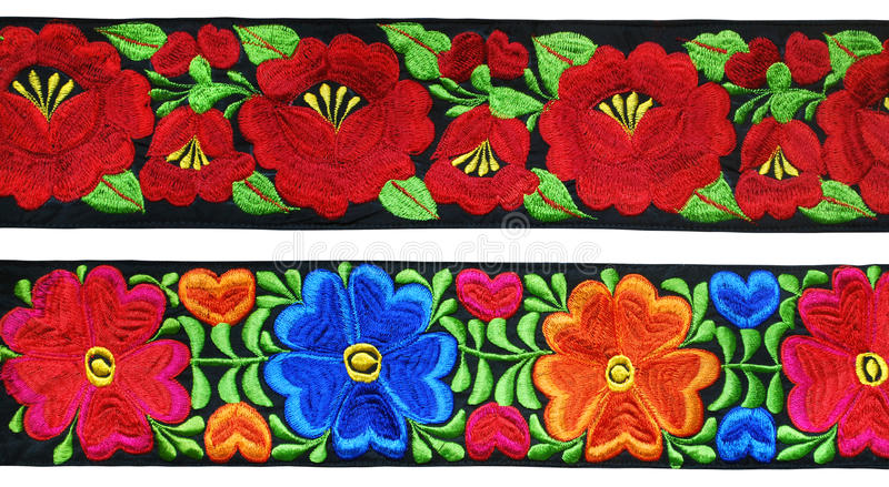 Mexican embroidery stripes. Traditional mexican flowers embroidery on black stripes stock images