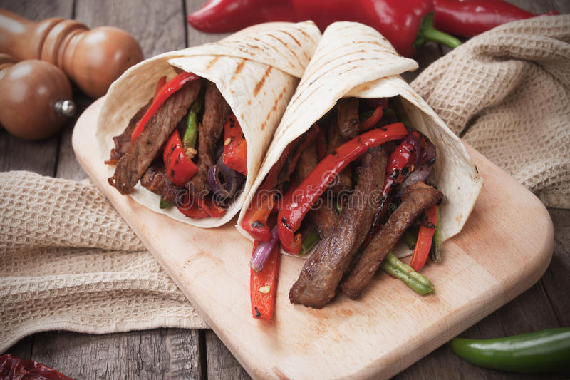Mexican fajitas in tortilla wrap royalty free stock photos