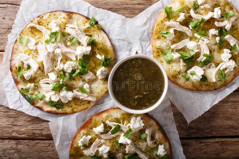 Mexican fast food: fried tortilla with chicken, cheese and green royalty free stock photo