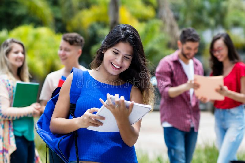 Mexican female university student with group of students royalty free stock images