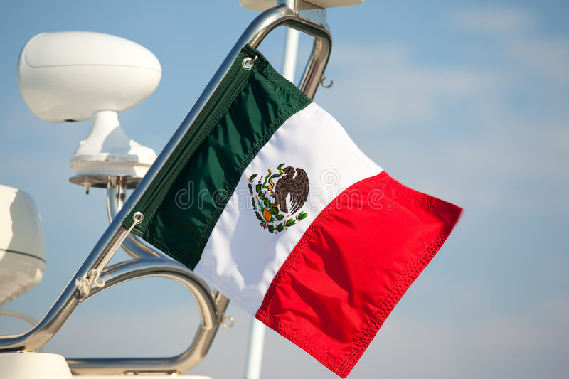 Mexican flag. A close up of the Mexican flag on a yacht royalty free stock photo