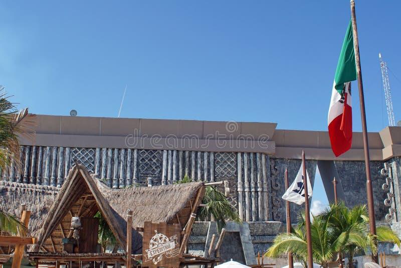 Mexican flag at the cruise ship terminal. Mexican flag flying above the cruise ship pier in Costa Maya, Mexico stock photo
