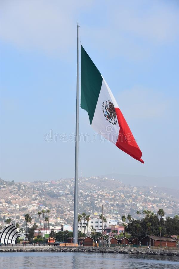 Mexican flag hoisted at the Port of Ensenada. In Mexico stock image