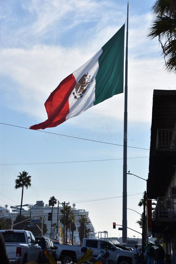 Mexican flag hoisted at the Port of Ensenada. In Mexico royalty free stock images