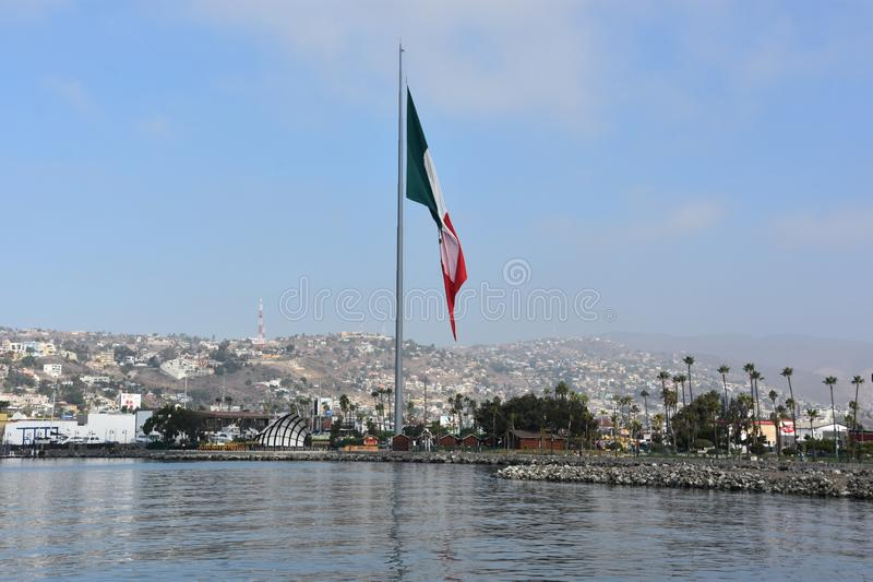 Mexican flag hoisted at the Port of Ensenada. In Mexico royalty free stock photo