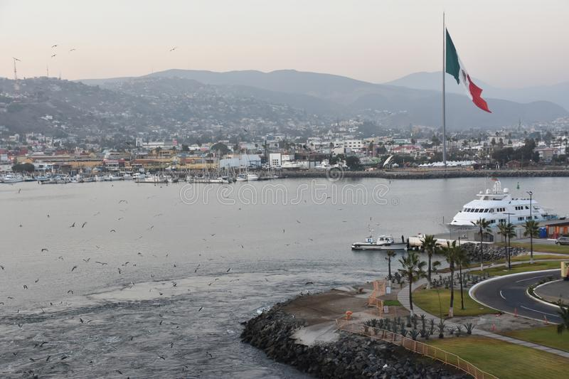 Mexican flag hoisted at the Port of Ensenada. In Mexico stock images