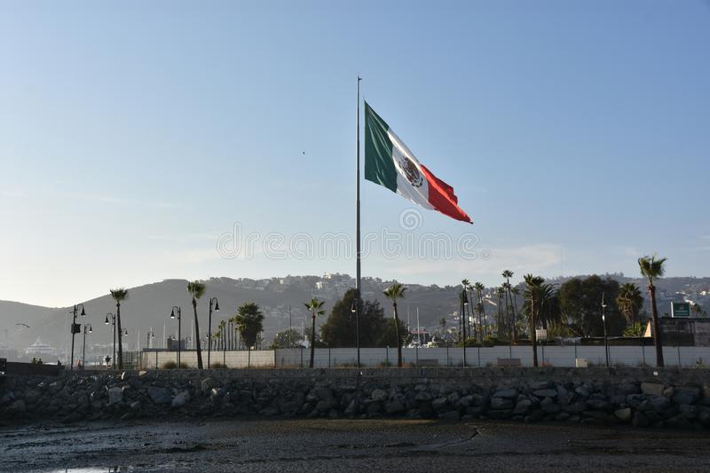 Mexican flag hoisted at the Port of Ensenada. In Mexico royalty free stock photos