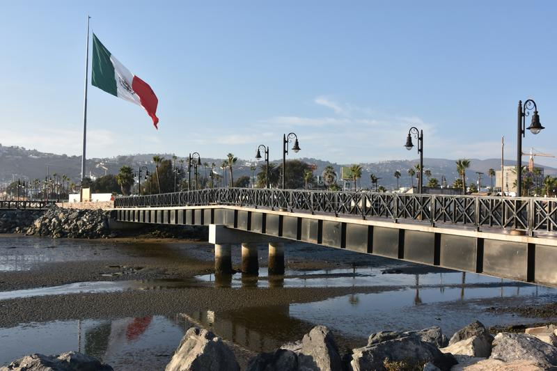 Mexican flag hoisted at the Port of Ensenada. In Mexico stock photography