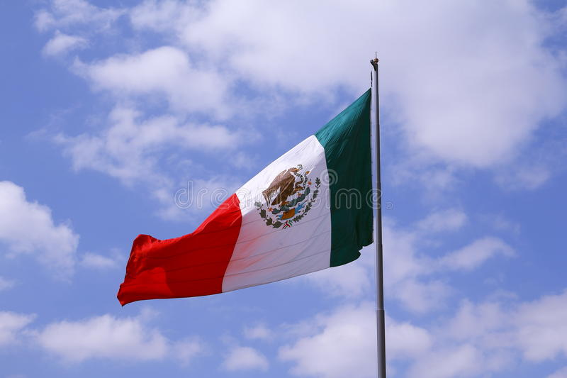 Mexican flag I. N a blue sky with clouds, mexico city, mexico royalty free stock photos