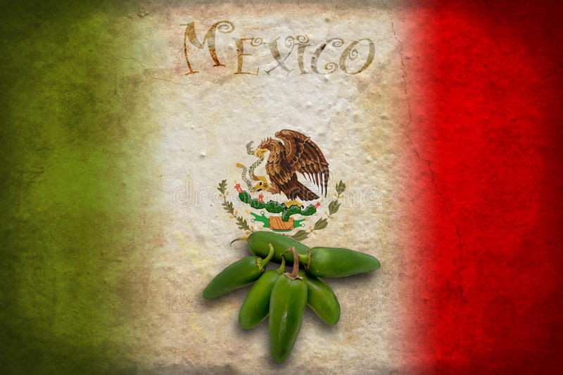 Mexican flag with jalapeno. Typical Mexican food: green jalapeno on Mexico flag stock photography