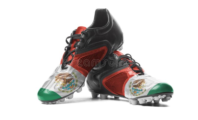 The Mexican flag. Painted on football boots. Isolated on white background royalty free stock images