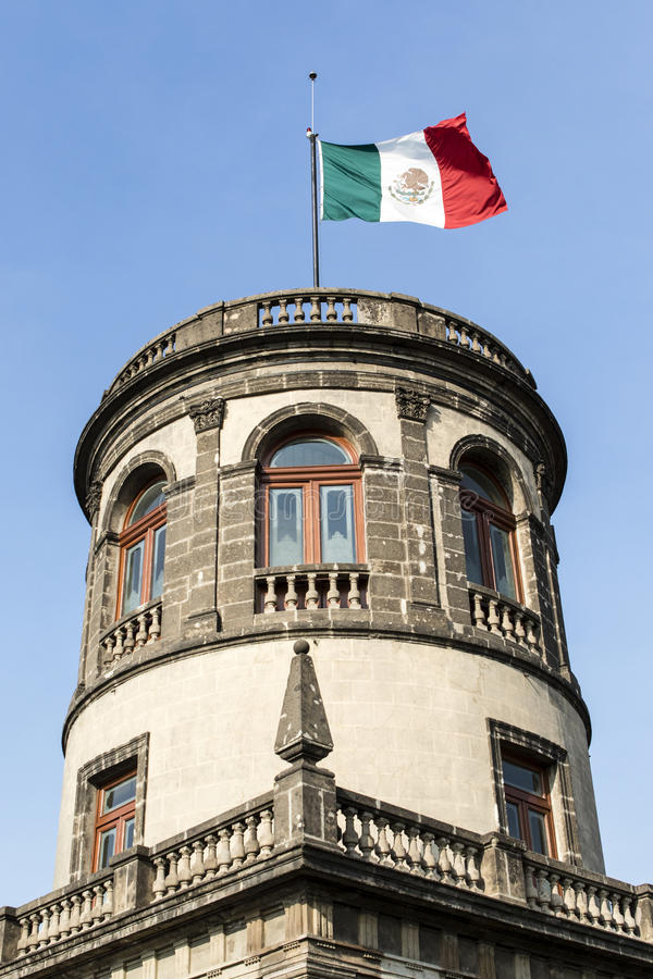 Mexican flag on top of Castle Chapultepec in Mexico City, Mexico. North America royalty free stock images