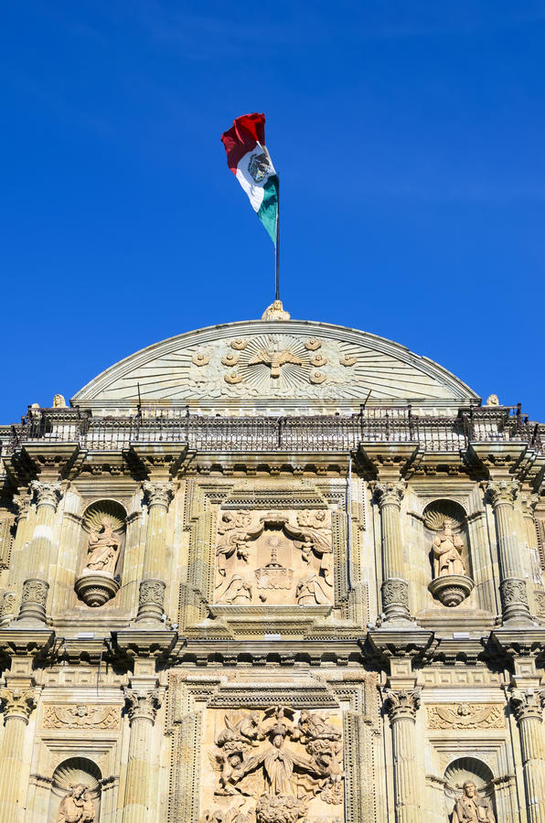 Mexican flag on top of Cathedral of Our Lady of the Assumption i. N Oaxaca royalty free stock image