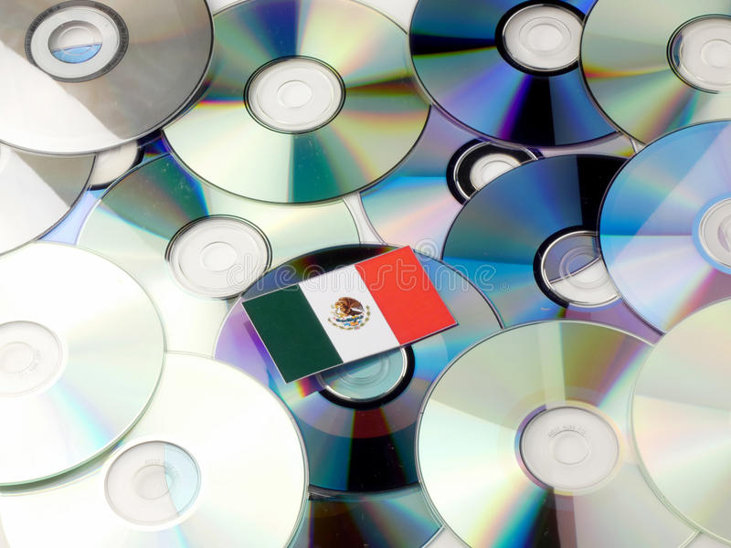 Mexican flag on top of CD and DVD pile isolated on white royalty free stock photo