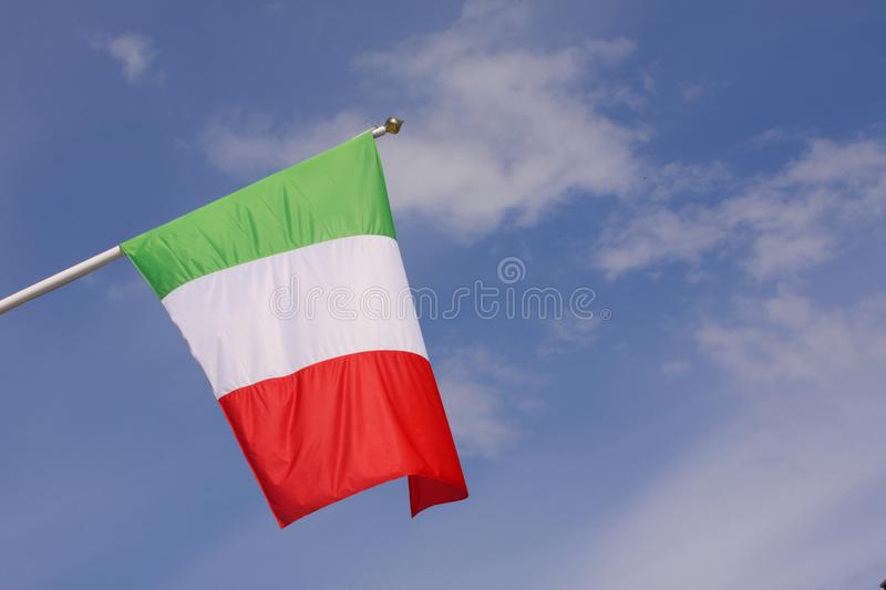 Mexican flag waving in the wind on a pole with blue sky background. Copy space. Mexican flag waving in the wind on a pole with blue sky background. With Copy royalty free stock photo