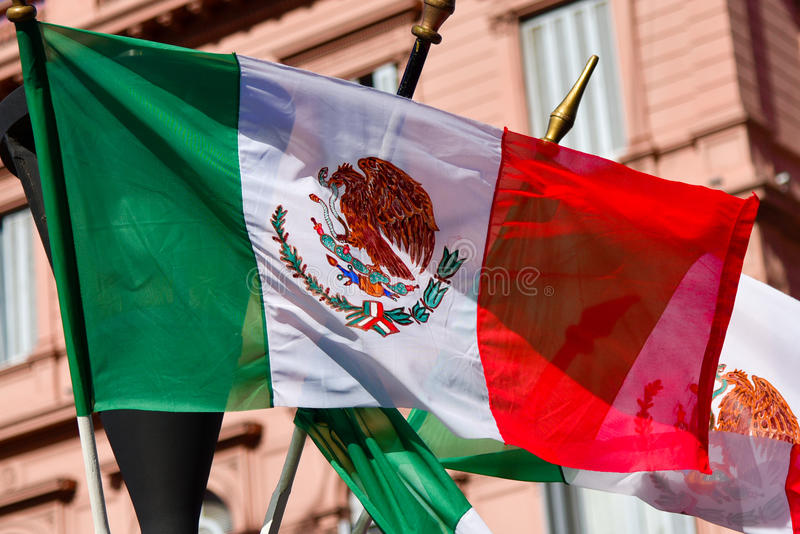 Mexican flag weaving on building background. Mexican flag weaving on a pink building background royalty free stock image
