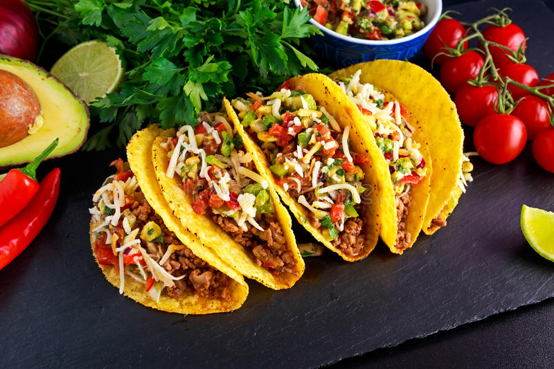 Mexican food - delicious taco shells with ground beef and home made salsa.  royalty free stock photography