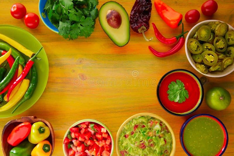 Mexican food mixed guacamole nachos chili sauce. Dipping cheddar cheese lemon pico de gallo stock image