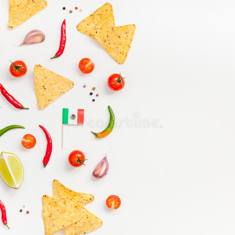 Mexican Food preparation cooking concept. Creative Top view flat lay of fresh mexican food ingredients with tortilla nachos chips garlic pepper lime tomatoes on stock photography