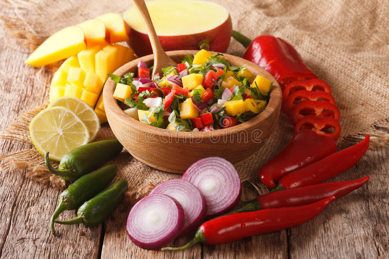 Mexican Food: salsa with mango, cilantro, onions and peppers closeup and ingredients. horizontal stock photos