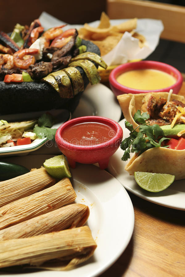 Mexican Food - Vertical. Vertical shot of a variety of Mexican dishes. Shallow dof with central portion of image in focus royalty free stock images