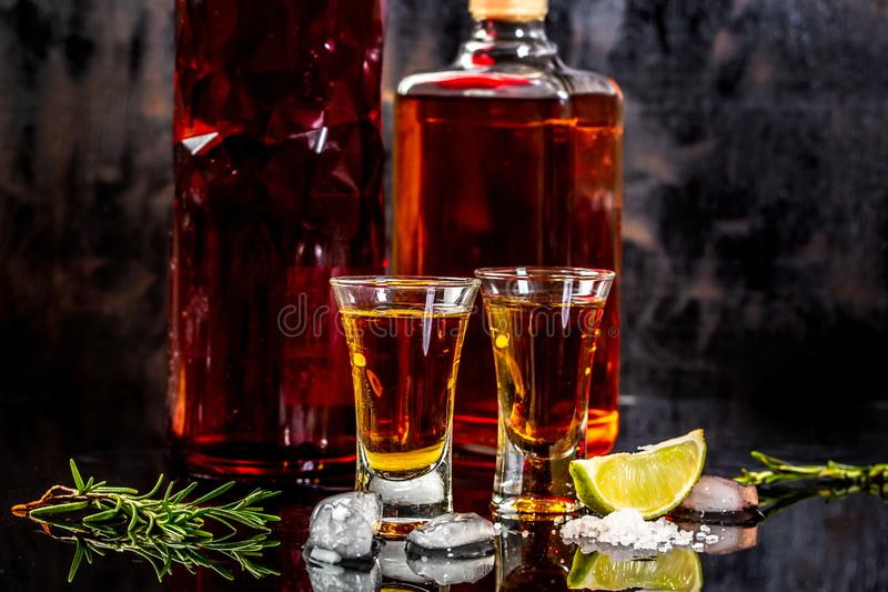 Mexican Gold Tequila with lime and salt on wooden table, concept of Mexican alcohol stock photo