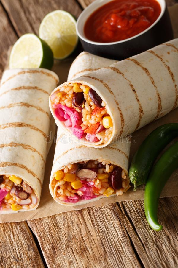 Mexican grilled veggie burrito with rice and vegetables served w royalty free stock photo
