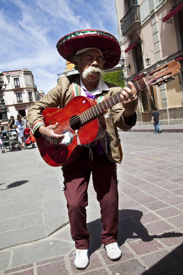 Mexican guitar musician on the streets of the Guan. Ajuato city. Guanajuato is a picturesque and historic city, is located in central Mexico. Its name derives royalty free stock image