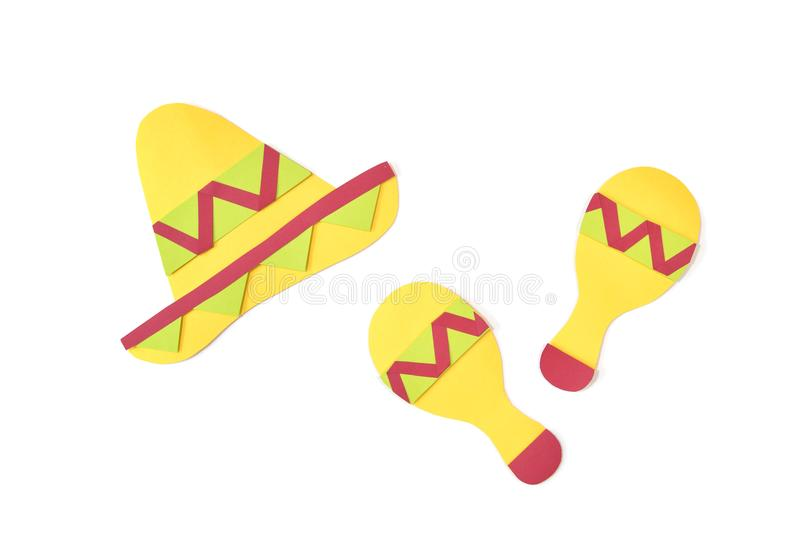 Mexican hat and maracas shaker paper cut on white background. Isolated royalty free stock image