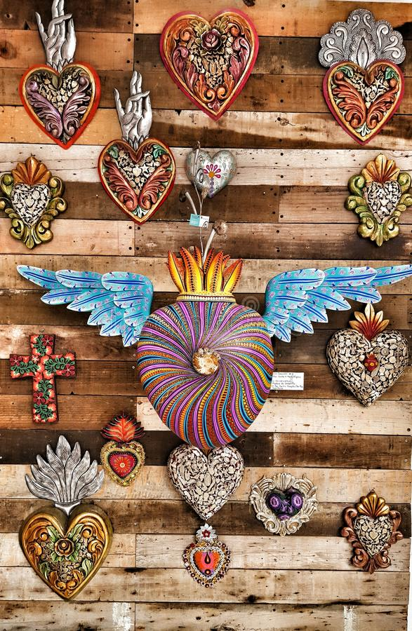 Mexican hearts. Coulorful mexican heart crafts made in Oaxaca royalty free stock photos