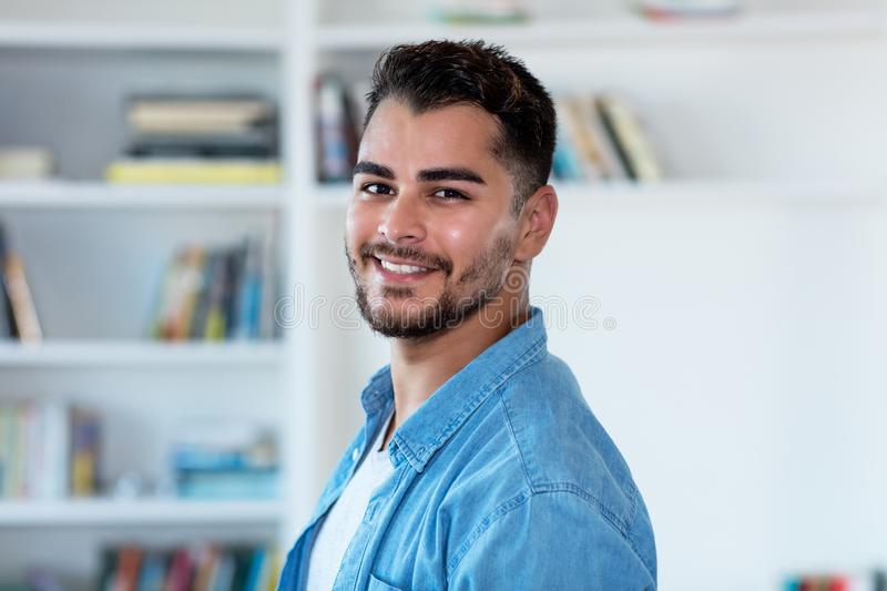 Mexican hipster man with beard indoor at home royalty free stock images