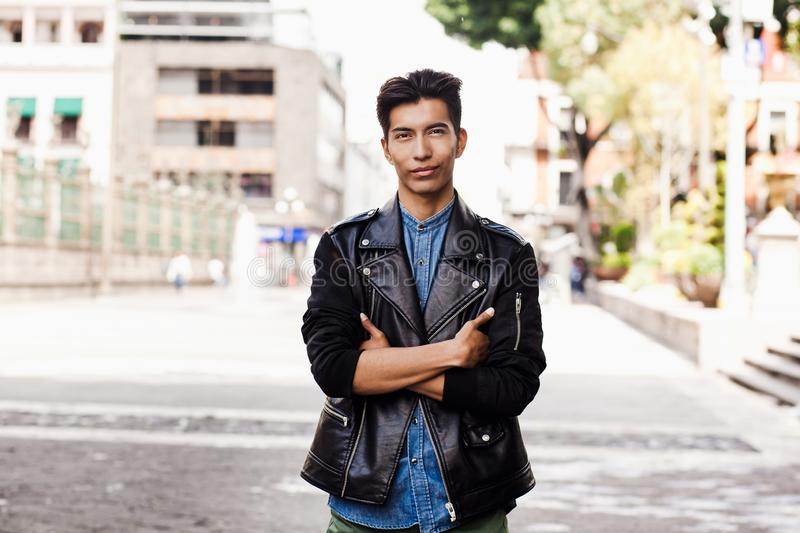 Mexican hispanic guy, portrait of young student man in Mexico city royalty free stock photography