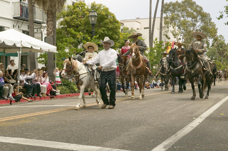 Mexican horseback riders trot along during the opening day parade down State Street of Old Spanish Days Fiesta held every August. In Santa Barbara, California stock images
