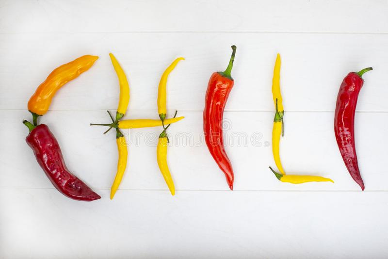 Mexican hot chili peppers colorful mix habanero poblano serrano jalapeno on wood stock photography
