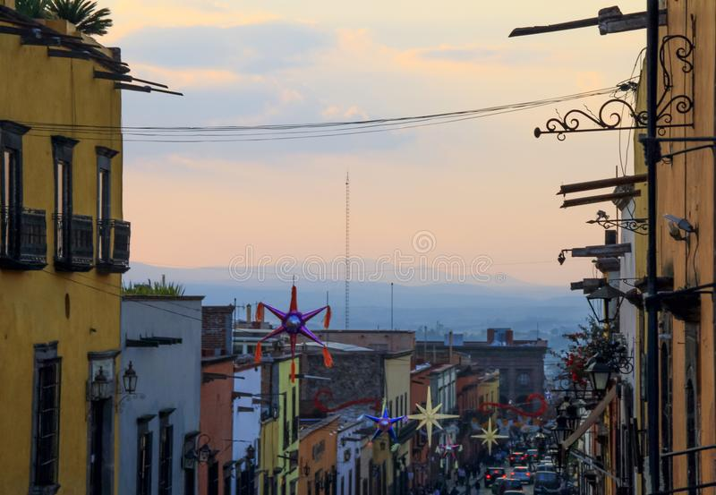 Mexican Houses and Suspended Street Decorations at. Multicolored Mexican Houses and Suspended Street Decorations at Sunset stock photos
