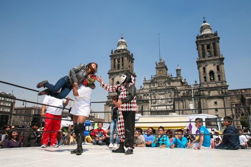 Mexican lucha libre on a Zocalo in Mexico City. MEXICO CITY -MARCH 2012-Mexican luchadors entertain unidentified people with lucha libre on a Zocalo on a weekend royalty free stock photos